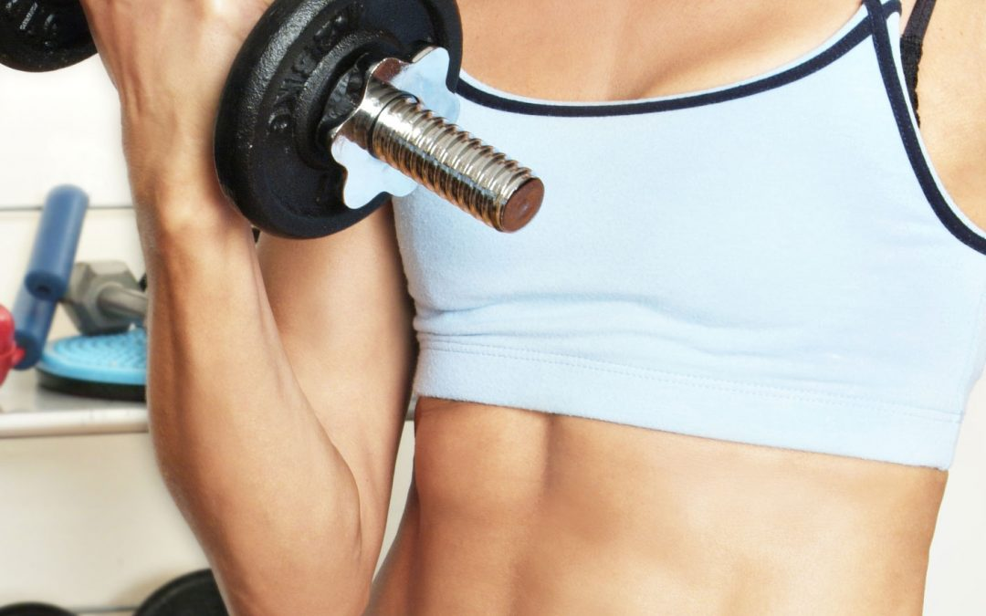 Losing weight- woman holding a dumbell
